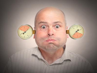 Stressed and overworked businessman under pressure. Mental health concept.